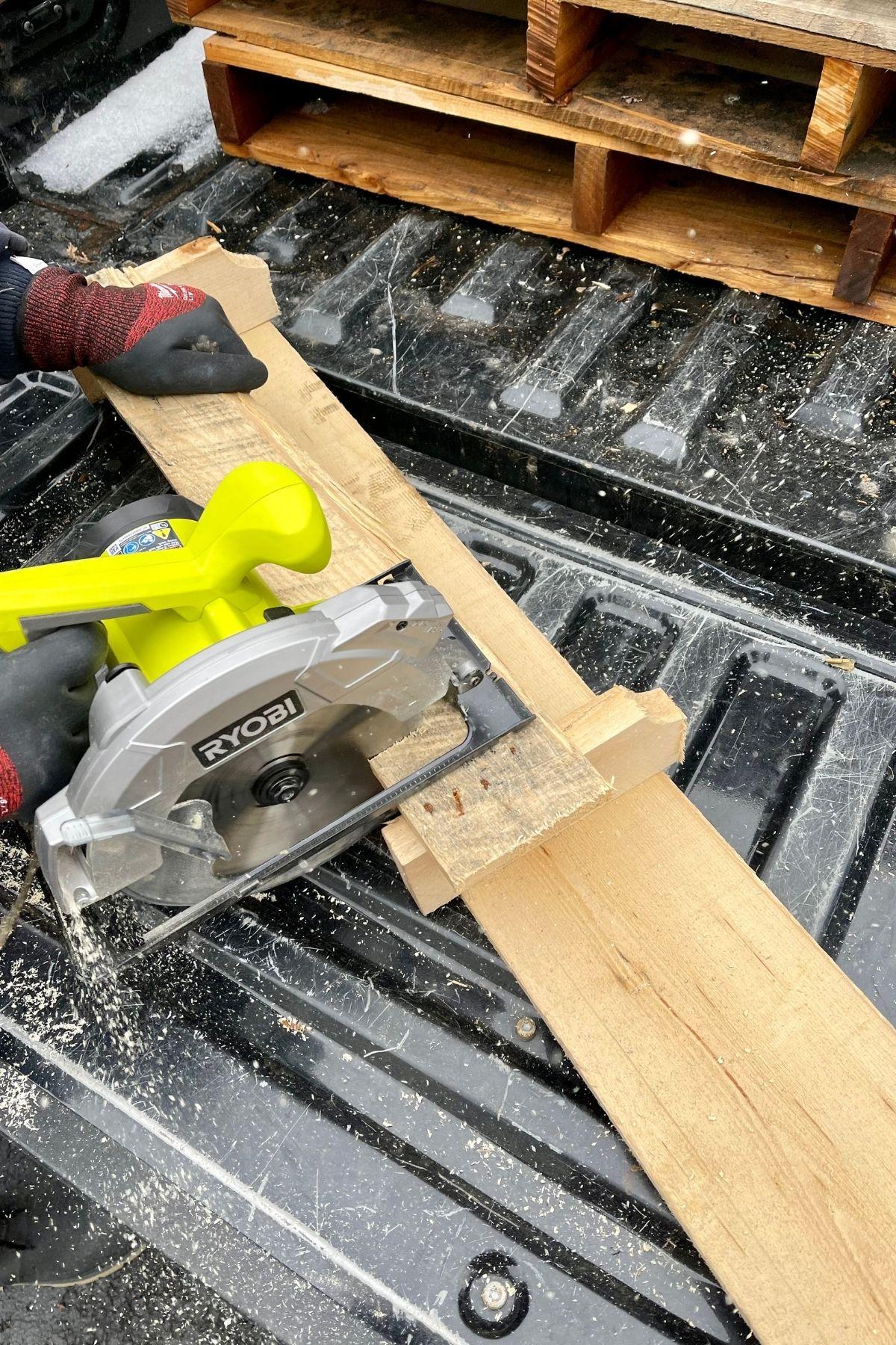 Cutting board with saw