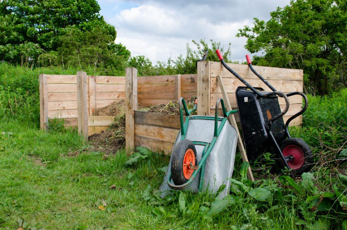 3 medium sized wooden compost bins.