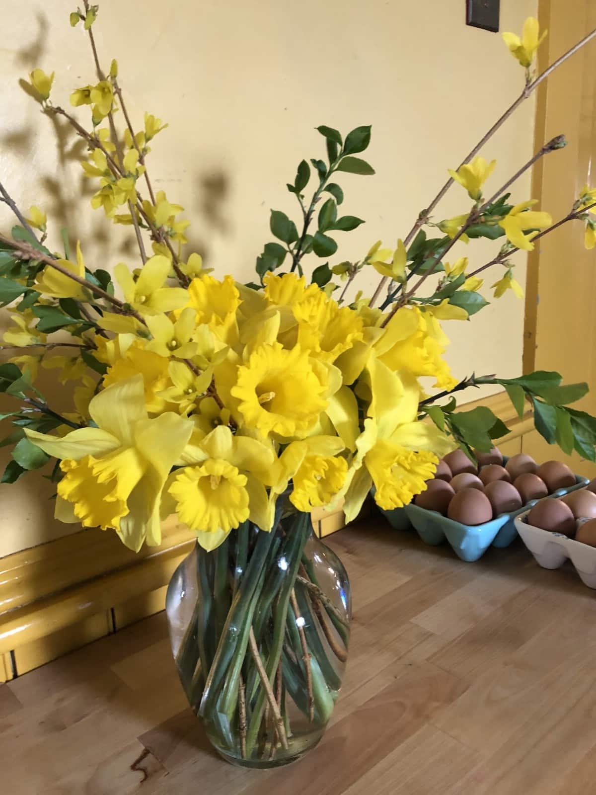 daffodil flower arrangement with filler greens