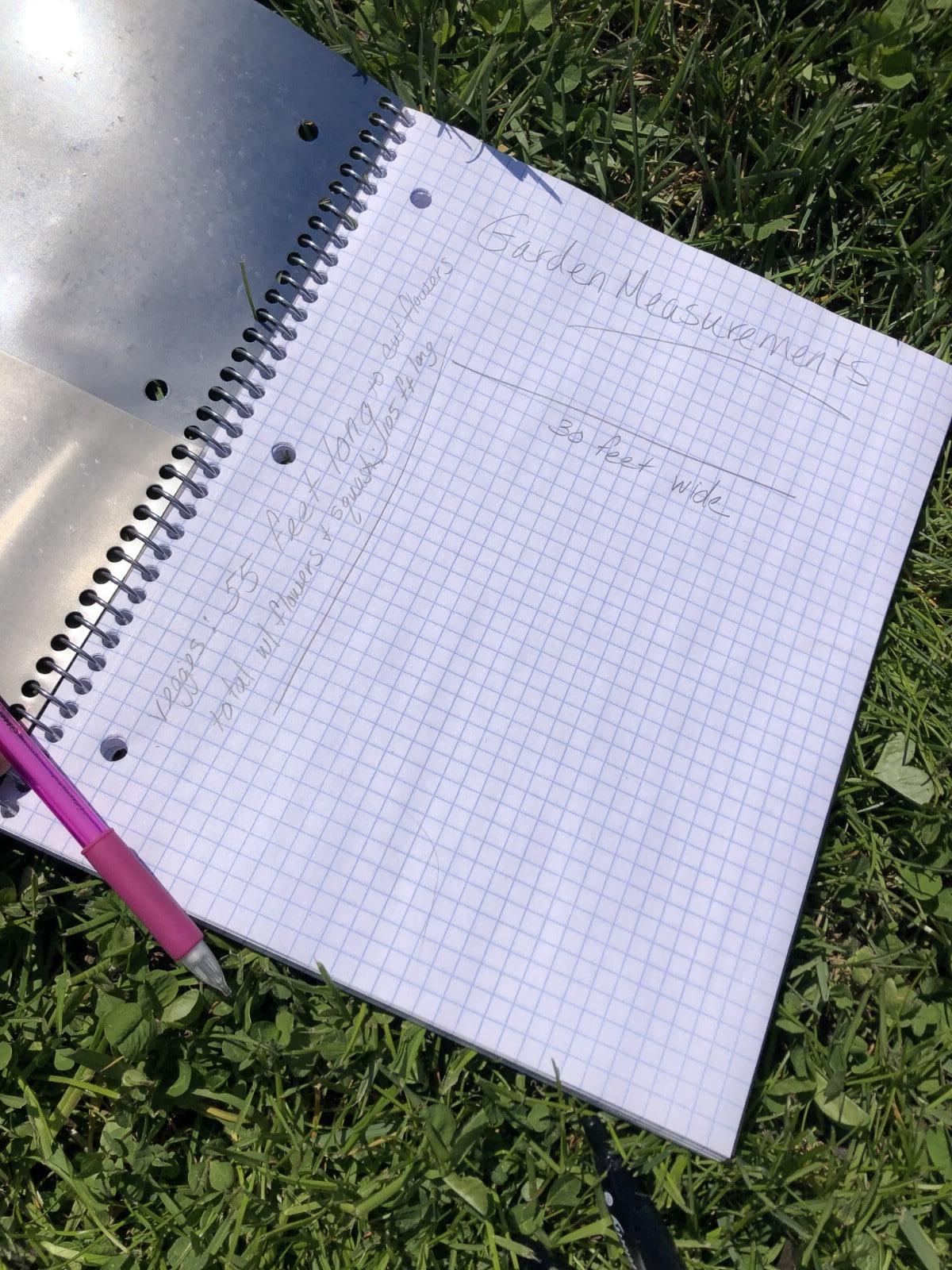 garden journal on grass with pencil