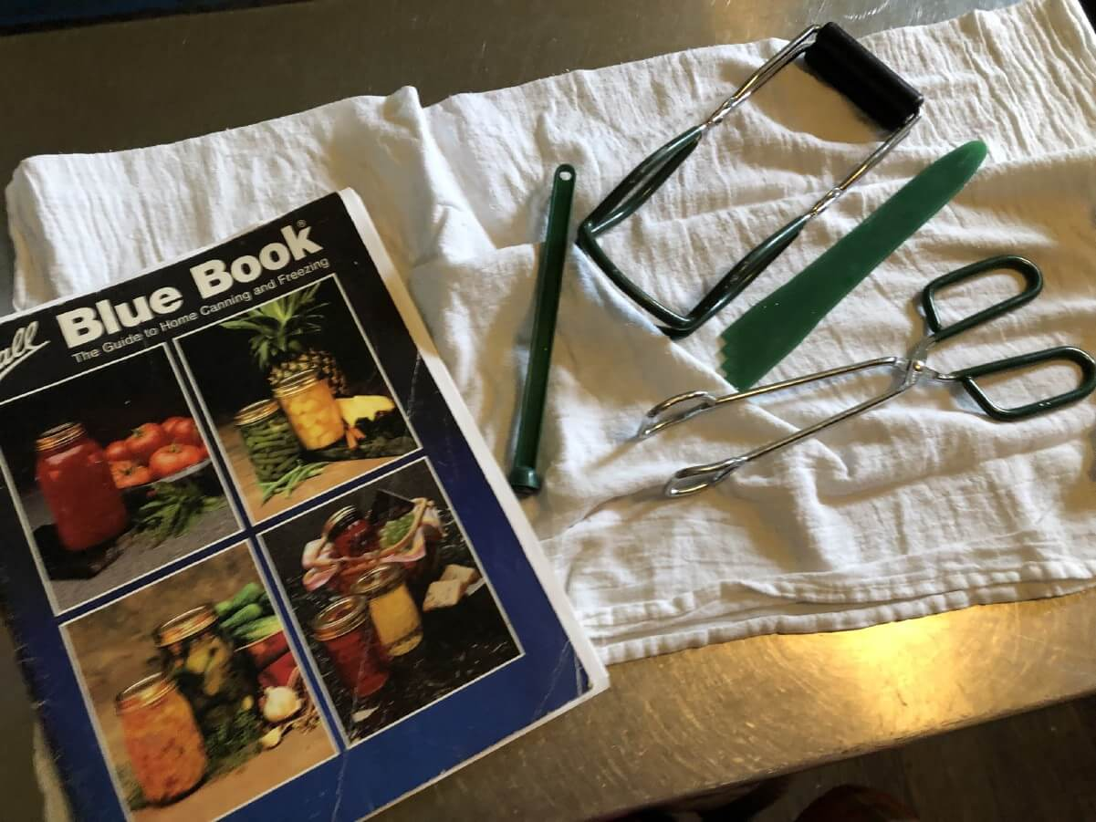 canning utensils and Ball Blue Book
