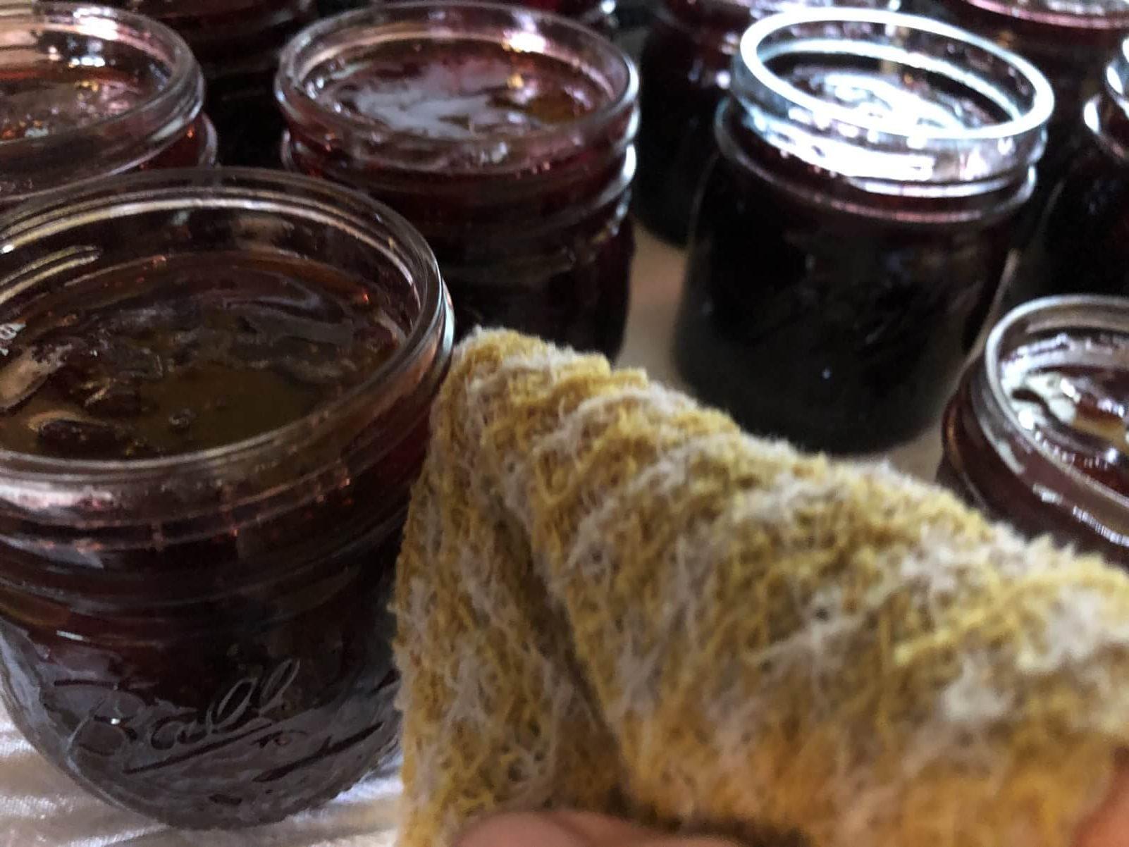 wipeing threads of jam jar before sealing