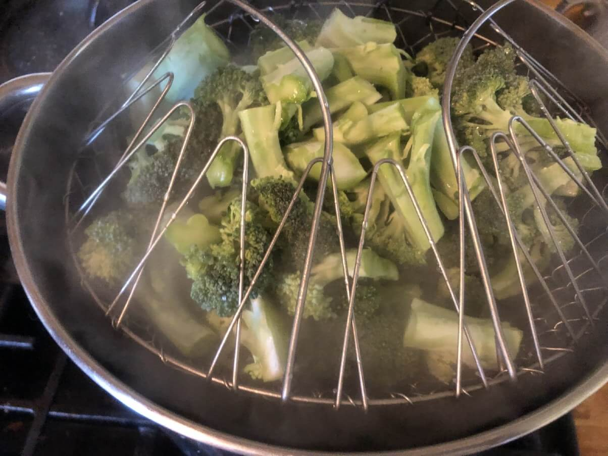 broccoli being blanched to be frozen