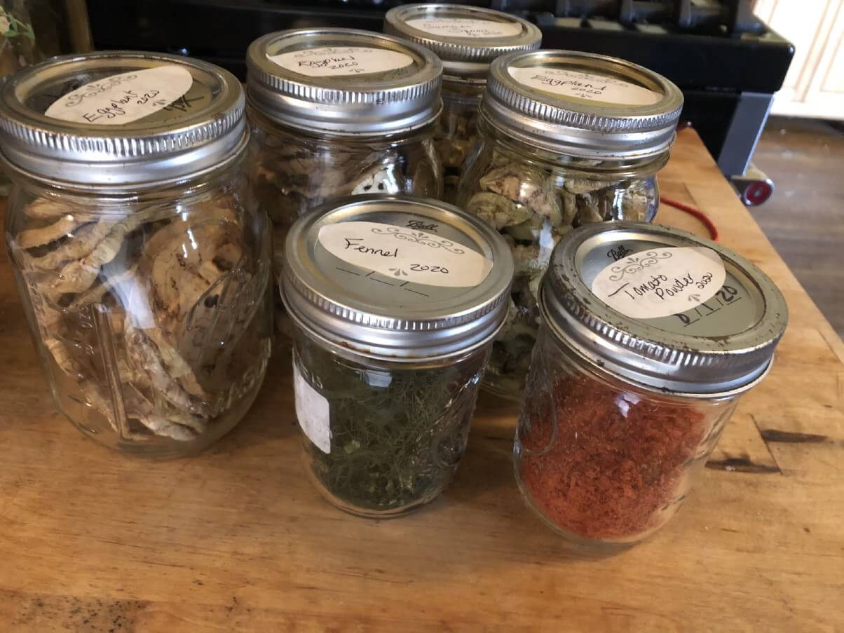 six cans of dried garden vegetables