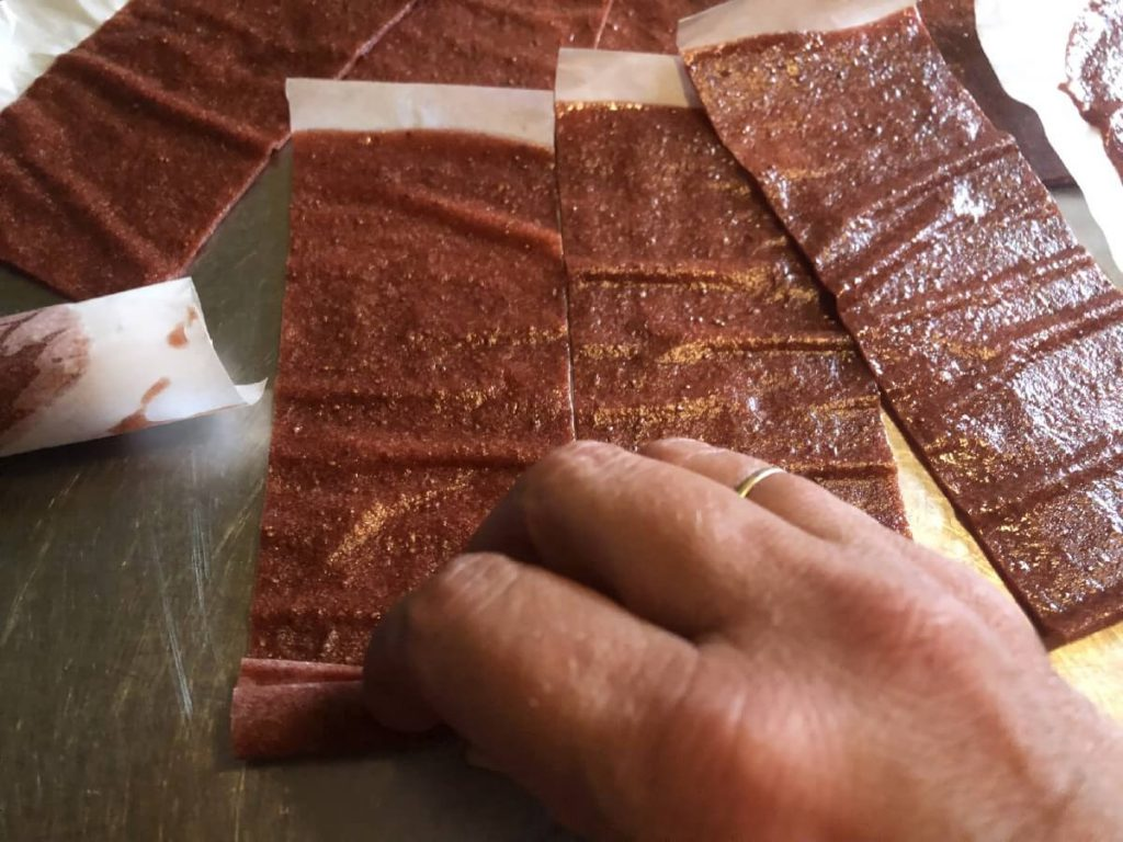 rolling up lined fruit leathers into personal serving size